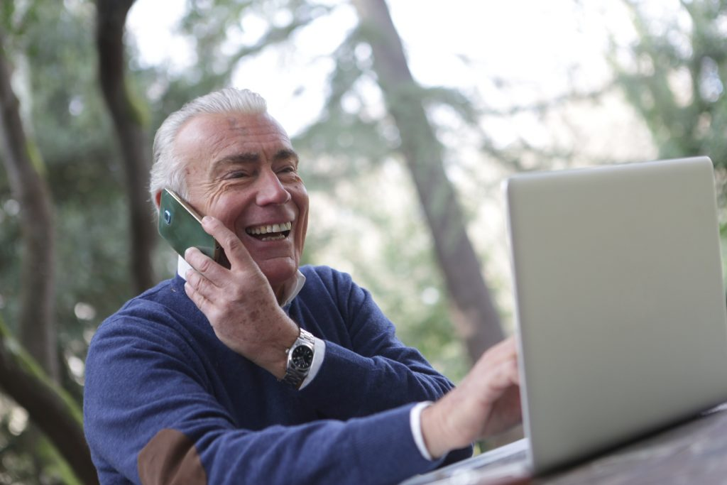 senior-on-phone-and-computer-1024x683