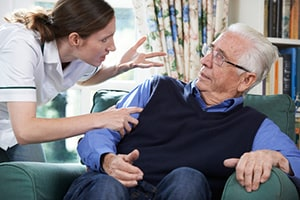 Nurse Yelling an Old Man